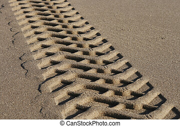 Tire tracks - close up of tire tracks in sand