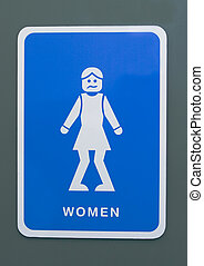 Urgency - Funny toilet sign of a woman with knees pressed...