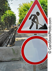 Road signs in street under reconstruction - Forbidding road...