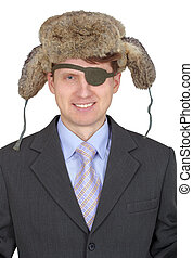 Laughing, one-eyed man in fur hat, on white background -...