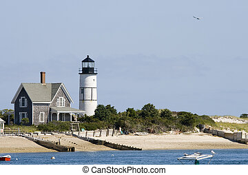 Lighthouse and home at Cape Cod - Wooden house and white...