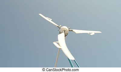 windmill rotated under strong wind on blue sky in sunny day,...