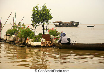 Tonle Sap lake - An unidentified woman on a floating village...
