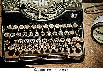 Old typewriter - Vintage typewriter on brown wooden table