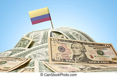 Flag of Colombia sticking in a pile of american dollars.(series)