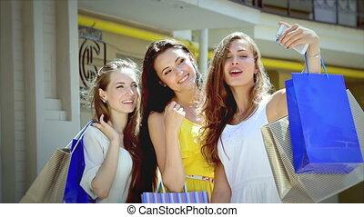 Young beautiful girl shopaholic make selfieie after shopping...
