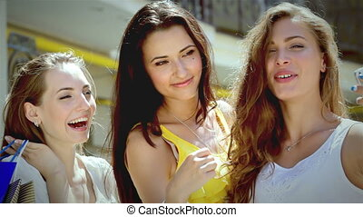 Three pretty girls-shopaholic make selfieie after shopping