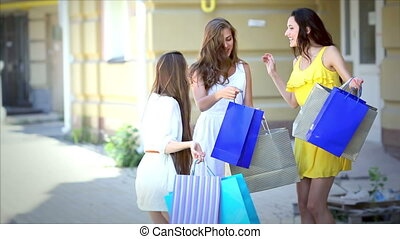Three pretty girls-shopaholic jumping for joy after shopping
