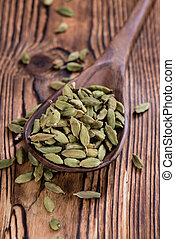 Cardamon (seeds) as close-up shot on vintage wooden...