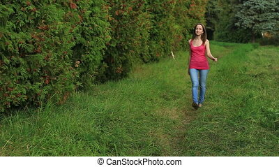Girl walking away through green alley