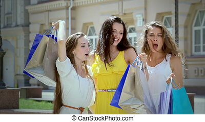 Three pretty girls-shopaholic emotionally rejoice in the...