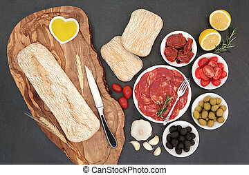 Antipasti with olives, salami, sundried and fresh tomatoes,...