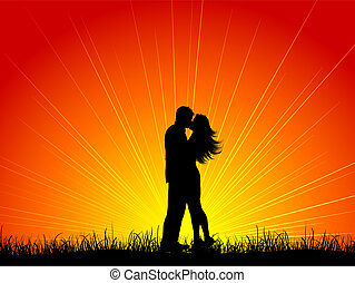 Kissing couple - Silhouette of a couple kissing against a...