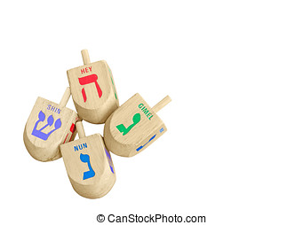 Group of Chanukah wooden dreidels isolated on white...