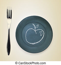 apple drawn with chalk in a plate - high-angle shot of a...