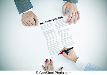 young woman signing a divorce decree document - high-angle...