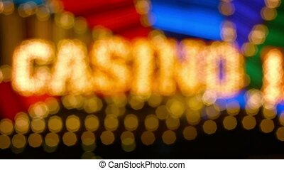 Bokeh effect from this slightly unfocused shot of a casino's flashy, brightly colored, neon sign at night