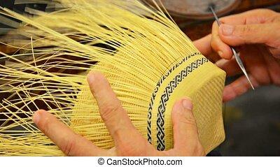 Local Artisan Creates Intricate Patterns in Straw Basket -...