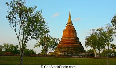 Lone Spire of Ancient Temple Ruin in Sukhothai, Thailand -...