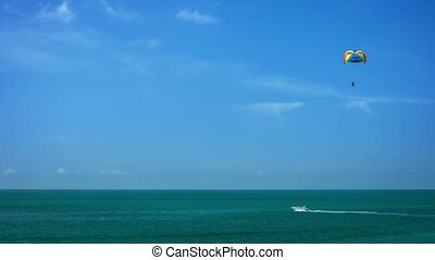 Parasailing in a Clear Blue Sky - Video 1080p - Parasailing...