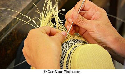 Local Artisan Weaving Colorful Patterns into Straw Basket -...