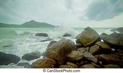 Large waves and rocks. Storm on the ocean coast