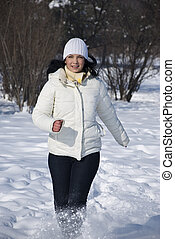 Woman running in winter