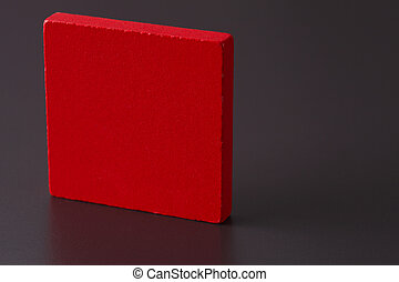 square wooden block - a red square wooden block