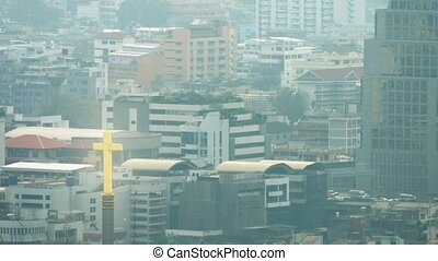 Slow Retreating Shot of Downtown Bangkok, Thailand on a Hazy...