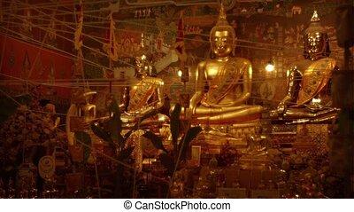 Golden Buddha Sculptures at Wat Phanan Choeng in Ayutthaya,...