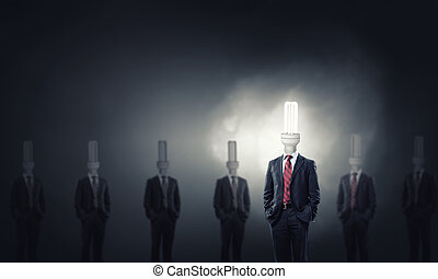 Stand out - Businessman in suit with light bulb instead of...