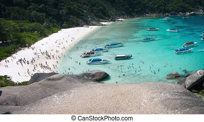 Tourists and boat traffic at the Similan Islands of Thailand...