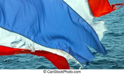 Tattered Thai National Flag on the Stern of a Tour Boat in...