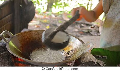 Woman Making Traditional, Native, Coconut Sweets on Borneo...
