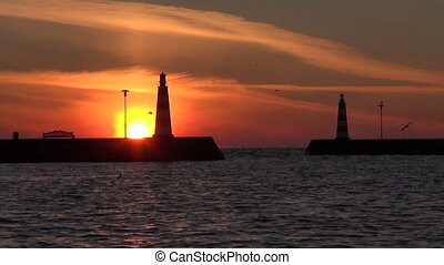 Lighthouses during sunset - Two lighthouses in the port...