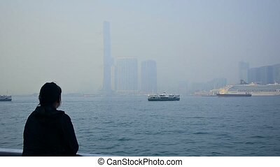 Tourist Gazing at the Harbor of a Major Metropolitan City in...