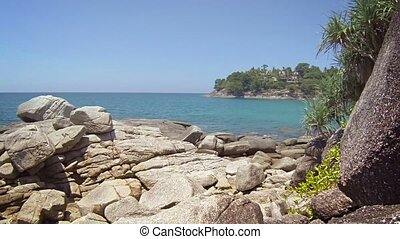 Overlooking a Beautiful, Rocky, Tropical Beach on a Sunny...
