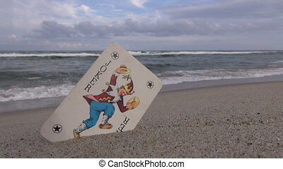 Joker card on the beach - Seascape with joker playing card...