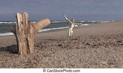 Crucifix and wooden log on beach - Seascape with crucifix...