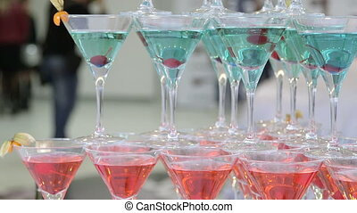 champagne martini glasses at event - Pyramid of red blue...
