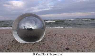 Glass ball object by the sea
