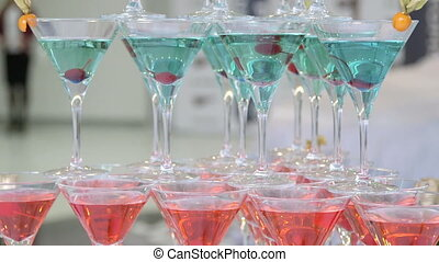 Pyramid champagne martini glasses at new car presentation in...