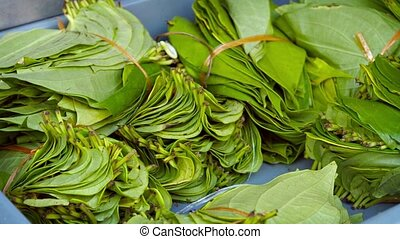Betel Leaves Bundled for Sale at Market - Video 1080p -...