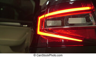 dealership showroom - Tail light of new car Skoda Superb...