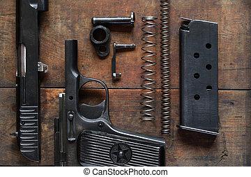 Dismantled Handgun - Soviet dismantled handgun on old wooden...
