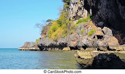 Crumbling Cliff Face along a Tropical Coastline - Video...