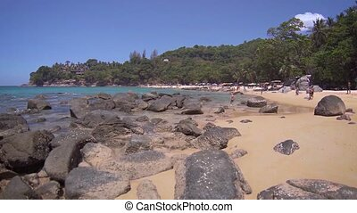 Tourists Enjoying a Rocky, Tropical Beach in Southeast Asia...