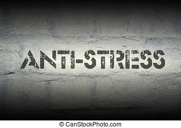 anti-stress stencil print on the grunge white brick wall