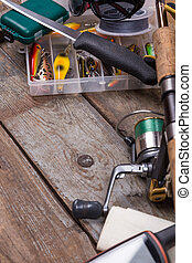 fishing tackles and fishing gear on tinber boards