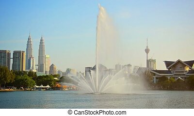 Beautiful Fountain Sprays Skyward in an Urban Park - FullHD...
